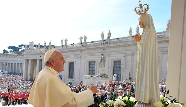 Pope with statue