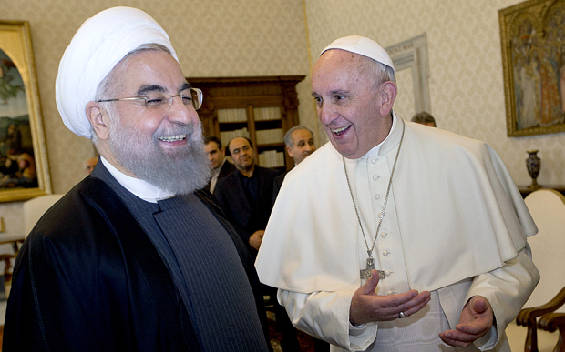 Pope Francis and Iranian President Hassan Rouhani, left, share a laugh during their private audience at the Vatican,Tuesday, Jan. 26, 2016. Iranís president has paid a call on Pope Francis at the Vatican during a European visit aimed at positioning Tehran as a potential top player in efforts to resolve Middle East conflicts, including Syriaís civil war. (AP Photo/Andrew Medichini, Pool)