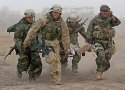 Soldiers carry fellow